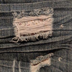 Distressed long jean shorts